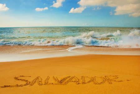 SALVADOR, BAHIA, BRAZIL: Inscription on the sand city of Salvador, drawing on the beach. South America