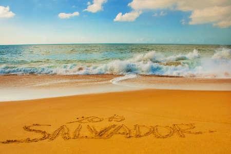 SALVADOR, BAHIA, BRAZIL: Inscription on the sand city of Salvador, drawing on the beach. South America Banco de Imagens