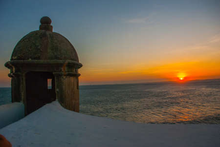 Beautiful sunset on the sea. Panoramic view of Barra Lighthouse in Salvador, Bahia, Brazil. South America