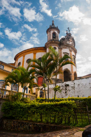 Ouro Preto, Minas Gerais: The famous Church of Saint Francis of Assisi, a Rococo Catholic church in Ouro Preto, Brazil in a cloudy sky day