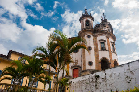 Ouro Preto, Minas Gerais: The famous Church of Saint Francis of Assisi, a Rococo Catholic church in Ouro Preto, Brazil in a cloudy sky day Banque d'images