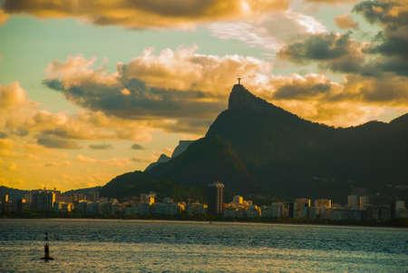 RIO DE JANEIRO, BRAZIL: The famous Rio de Janeiro landmark - Christ the Redeemer statue on Corcovado mountain, shot during beautiful sunset. Beautiful landscape with sunset view.