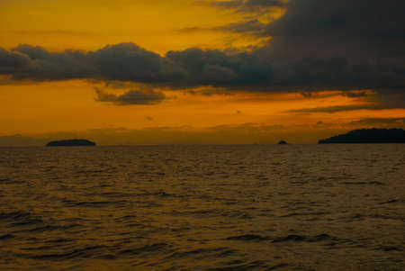 Angra dos Reis, Brazil, Ilha Grande: Beautiful scenery with ships overlooking the sea and mountains at sunset. Brazilian Caribbean. Imagens