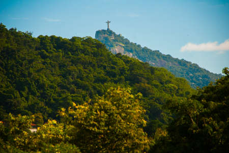 Christ the Redeemer statue on the top of a mountain, Rio De Janeiro, Brazil, America.