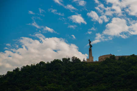 BUDAPEST, HUNGARY: Wide angle view of the Liberty Statue or Freedom Statue stands on Gellert Hill above the city of Budapest.