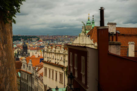Top view to red roofs skyline of Prague city, Czech Republic. Aerial view of Prague city with terracotta roof tiles, Prague, Czechia. Old Town architecture with terracotta roofs in Prague Stok Fotoğraf