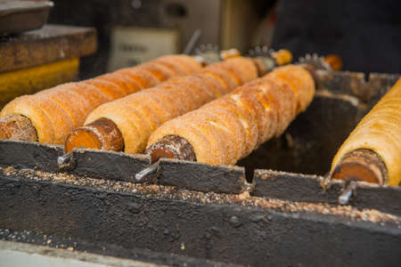 Prague, Bohemia, Czech Republic: famous trdelnik sweet roll cooking at shop