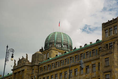 Prague, Czech Republic: Dome of the Ministry of Industry and Trade of the Czech Republic Building with Czech Flag and Sculptures Symbolizing Industry, Trade, Crafts and Navigation Reklamní fotografie