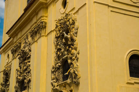 Relief sculpture on facade of the Church of Saint James The Greater with Minorite monastery in Old Town of Prague, Czech Republic, sunny day Stok Fotoğraf