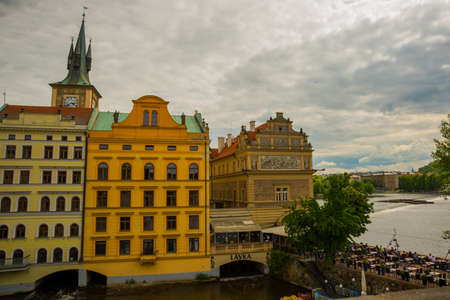 Prague, Czech Republic, Europe: Beautiful view of the old town. Panoramic landscape with houses, churches, trees and a river. Stok Fotoğraf