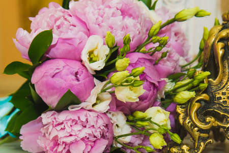 Beautiful romantic Bridal bouquet of pink peonies. Wedding day.