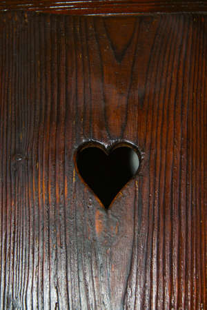 Bran, Romania: A door with a hole in the shape of a heart. The Interior of the medieval Bran Castle, home of Vlad Tepes Dracula, Brasov, Transylvania, Romania, Europe