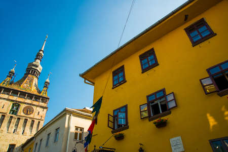 Sighisoara, Romania: View of the ocher-colored house - the birthplace of Vlad Dracula. It was he who inspired Bram Stoker to the fictional creation of Count Dracula. Europe Stock Photo
