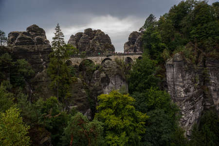 Bastei - View of beautiful rock formation in Saxon Switzerland National Park from the Bastei bridge - Elbe Sandstone Mountains near Dresden and Rathen - Germany. Popular travel destination in Saxony.