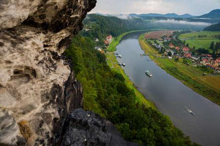 View from viewpoint of Bastei in Saxon Switzerland, to Elbe river and Kurort Rathen, National park Saxon Switzerland. Mist over the river Elbe. Germany, near Dresden Reklamní fotografie