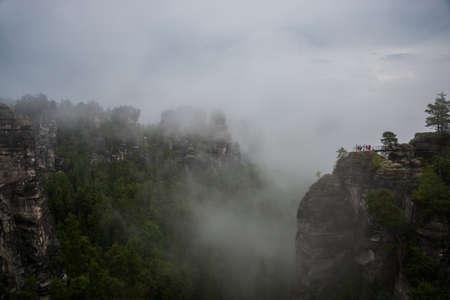 Bastei, Germany: Beautiful landscape with bastey rocks in the national Park Saxon Switzerland, Kurort Rathen, Dresden. Fog in the mountains Reklamní fotografie