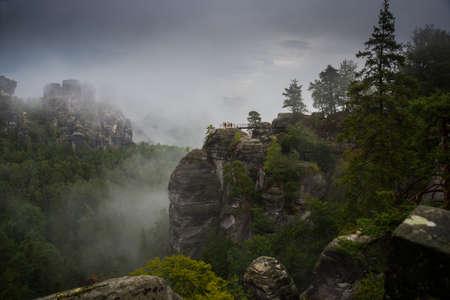Bastei, Germany: Beautiful landscape with bastey rocks in the national Park Saxon Switzerland, Kurort Rathen, Dresden. Fog in the mountains