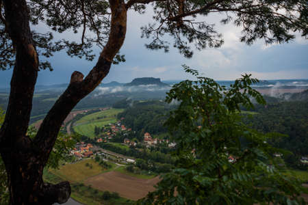 Saxon Switzerland, Germany: View from viewpoint of Bastei in Saxon Switzerland, to Elbe river and Kurort Rathen, National park Saxon Switzerland. Mist over the river Elbe.