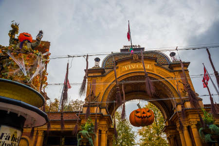 Denmark, Copenhagen, Europe: Entrance to the Tivoli park with decorations for the holiday - Halloween