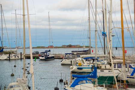 COPENHAGEN, DENMARK: Luxury speedboats docked along side of wooden promenade at Danish capital of Copenhagen. Denmark Banco de Imagens