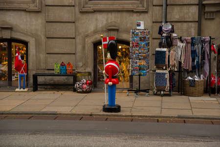 Copenhagen, Denmark: Real soldier figure as attraction of a souvenir shop, in the urban center of the city of Copenhagen, Denmark