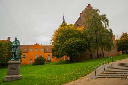 Statue of the famous novelist Hans Cristian Andersen in his born city: Odense in Funen, Denmark, Europe Stock Photo