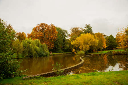 Odense, Denmark: Beautiful view of the pond in autumn in the Park. Hans Christian Andersen fairytale garden in Odense in Denmark, Europe