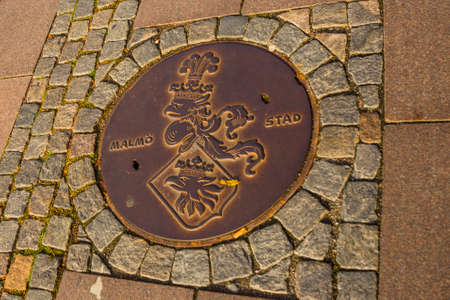 MALMO, SWEDEN: Closed manhole cover on a city street in city of Malmo, Europe