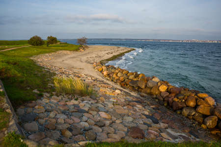 Helsingor, Elsinore, Denmark: Beautiful view from Denmark Kronborg Castle to the sea and rocks on the horizon Sweden and the port Helsingborg in Sweden. Banque d'images