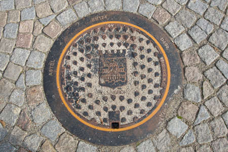 Helsingborg, Sweden: Beautiful manhole on the road of stone on the street