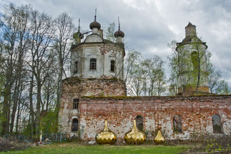 landscape in the village view of an old ruined Church with Golden cupolas on the groundnt Banco de Imagens