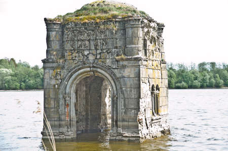 The flooded bell tower of the Church of the Vladimir icon of the Mother of God, 1795, on the river Vazuza, in the former village of Arkhangelsk-Chashnikovo Archivio Fotografico