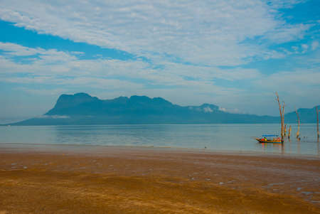 BAKO, KUCHING, SARAWAK, BORNEO, MALAYSIA: beautiful landscape with views of the Bako national Park beach landscape with rocks with mountain views, near Kuching