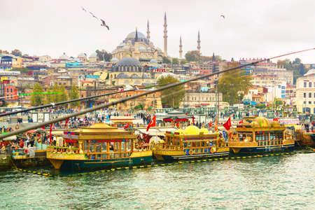 Istanbul,Turkey: View of Istanbul Old City from Galata Bridge. Colourful midday business of Istanbul. Sea view of Istanbul.