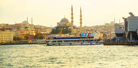 ISTANBUL, TURKEY - OCTOBER 2018: City view from the water to the mosque. Tourist Istanbul city landscape.