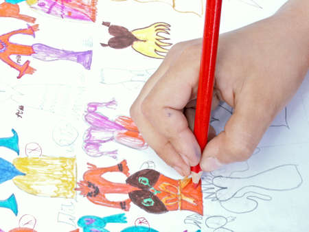 slovenly: The child draws a color pencil. Stock Photo