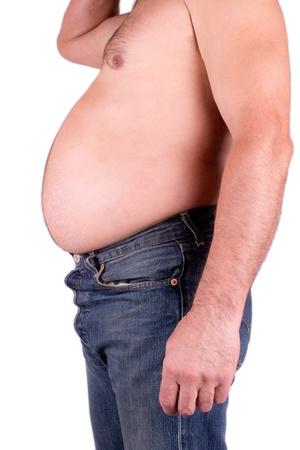 sobrepeso: El hombre gordo con pantalones vaqueros aislados