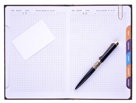 On the notebook is pen and paper clip Stock Photo