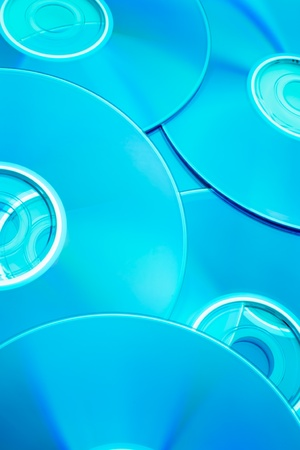 placer: Placer CD photographed at an angle in a turquoise color
