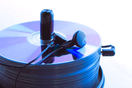 Headphones and a stack of compact discs on the isolated Stock Photo - 10916250