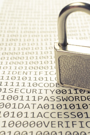 Padlock is on the list with a binary code and few words about safety Stock Photo