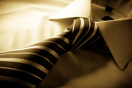 Tie cast shadows on the shirt tied knot, sepia