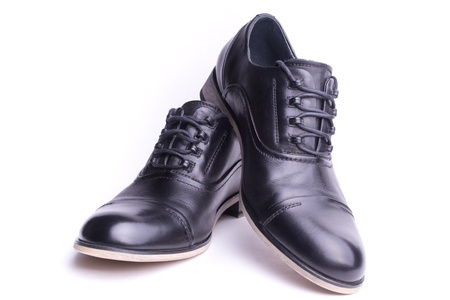 A pair of mens shoes, one above the other, isolated