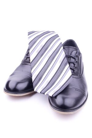 A pair of men's shoes and tie, isolated Stock Photo - 10916317