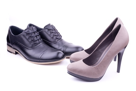 A pair of mens and womens shoes, isolated Stock Photo