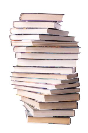 Spiral stack of books isolated on white photo