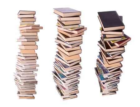 Three stacks of books isolated on white photo