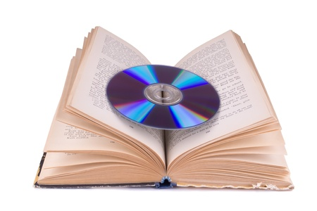 Open book and compact disc isolated on white Stock Photo - 11118843