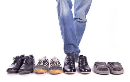 trousers: A man wears a new pair of shoes isolated