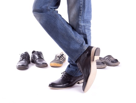 Mens feet in new shoes crosswise isolated Stock Photo